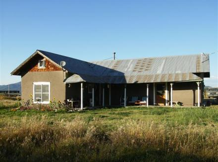The house on 17 irrigated acres from the Acequia de San Juan Nepomoseno del Llano.  Water rights since 1789 (Photograph by Taos Properties).